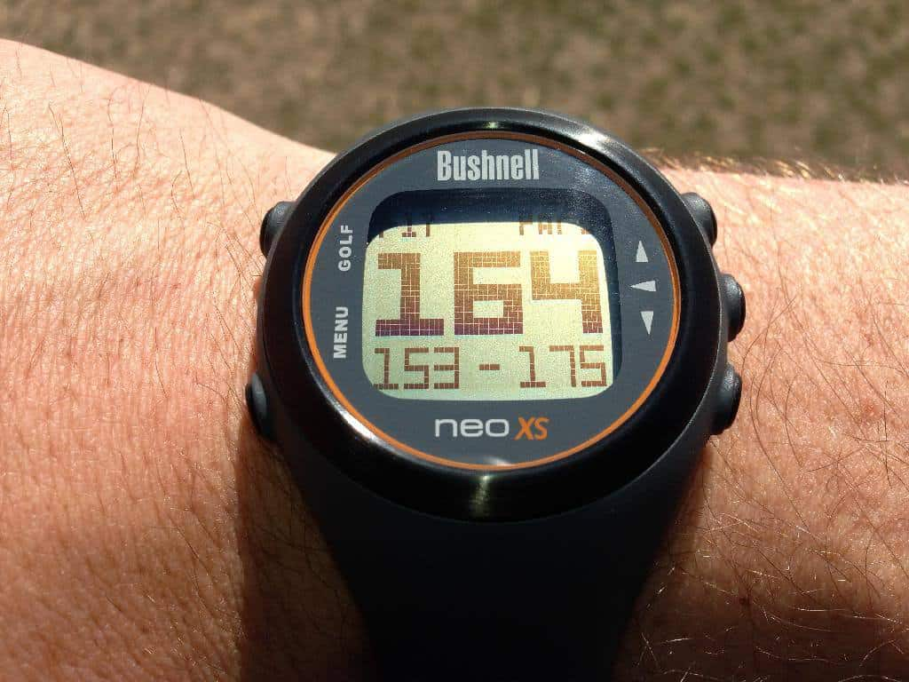 This is an image of the yardage function on a bushnell neo XS golf gps watch on a man's arm.