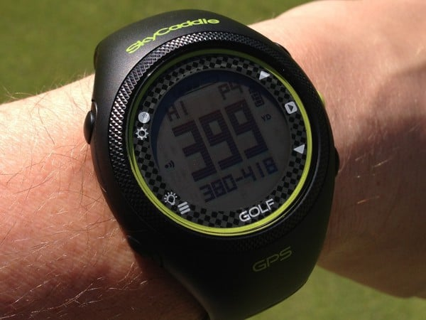 Image of the watch face on the skycaddie golf gps watch on a man's arm.